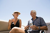 Couple with wine on boat