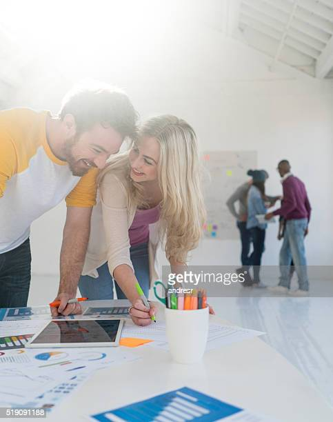 Couple working at a creative office