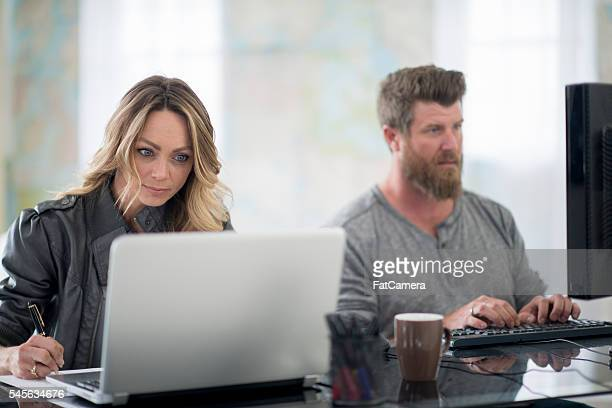 Couple Working From Their Home Office