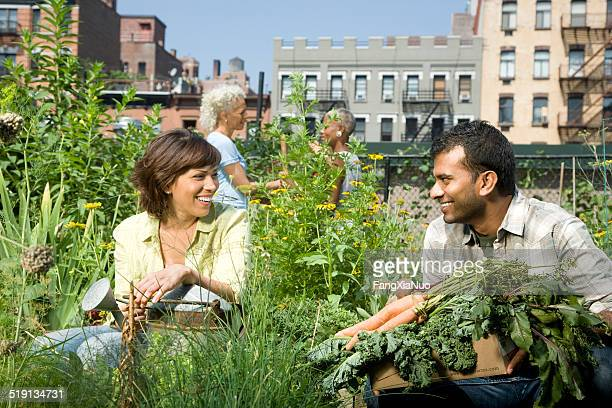 Couple working in a community garden