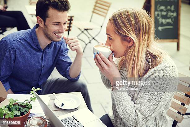 Couple working in cafe