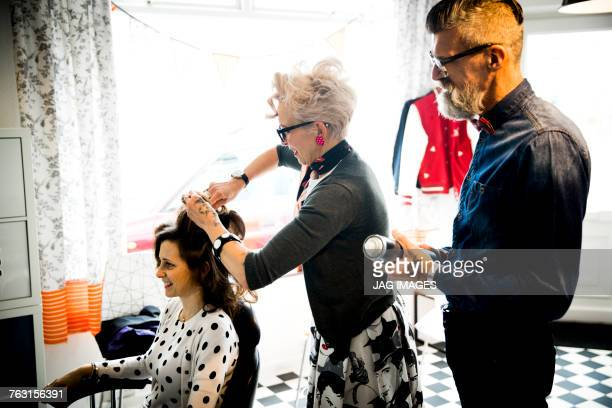 Couple working in hair salon