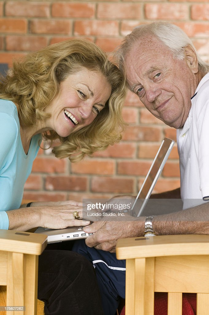 Couple working on a laptop : Stock Photo