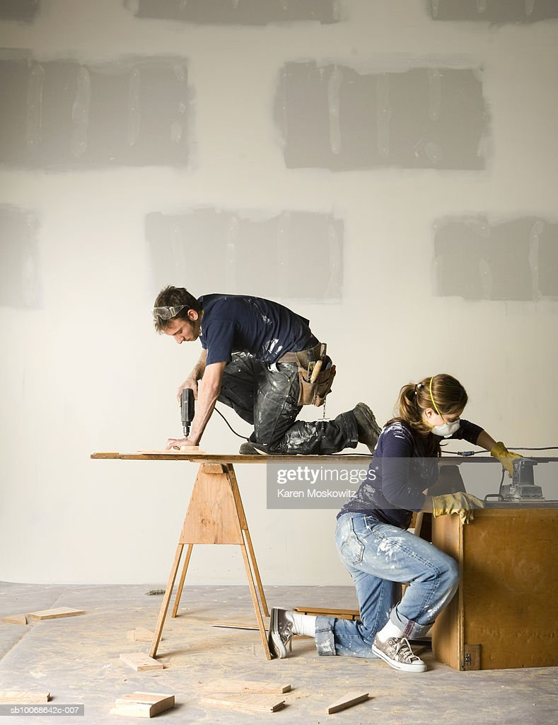 Couple working on home remodelling project : Stock Photo
