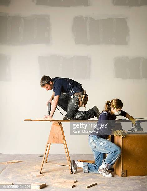 Couple working on home remodelling project