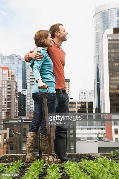 Couple working on roof garden