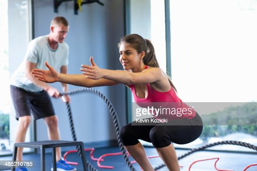 Couple working out in gym