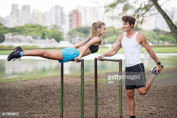 Couple working out together, Skyline in back