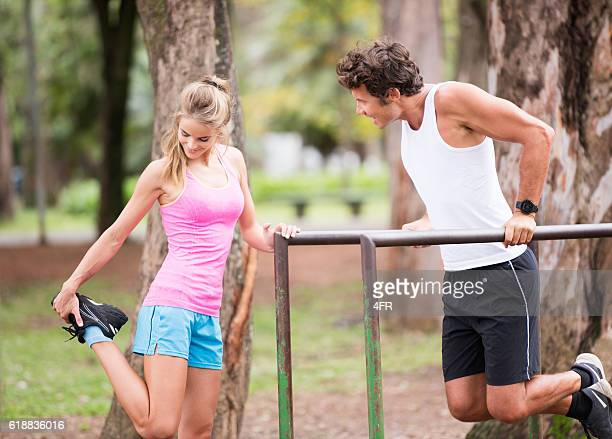 Couple working out together, Stretching and Dips