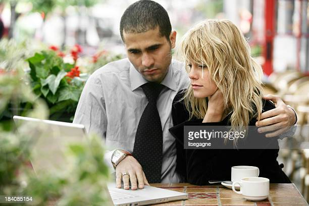 Couple working outdoors