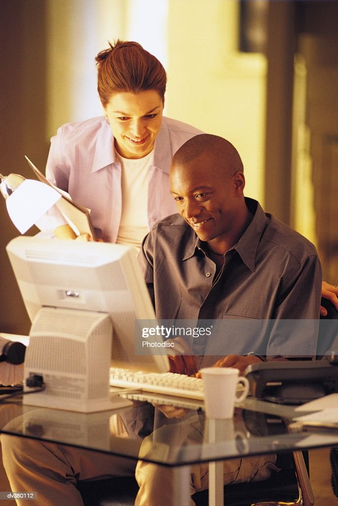 Couple working together in home office : Stock Photo