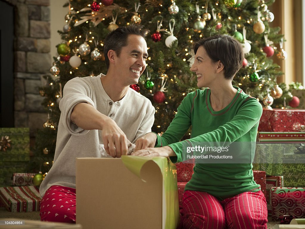 couple wrapping presents : Stock Photo
