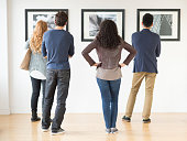 Couples admiring art in gallery