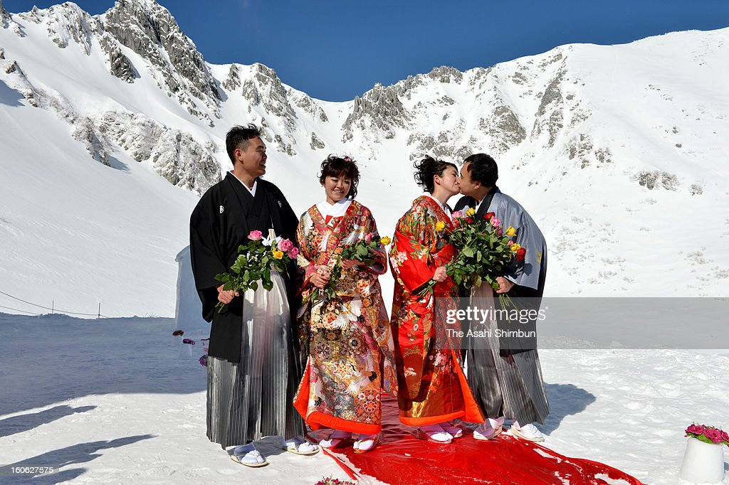 Couples attend the 'Pure White Wedding' hosted by Komagane City at Senjojiki Kar on February 3, 2013 in Komagane, Nagano, Japan. The snow field is located 2650 meters above the sea level and the wedding was held in eleven degrees below zero.
