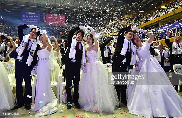 TOPSHOT Couples celebrate during a mass wedding held by the Unification Church at Cheongshim Peace World Center in Gapyeong east of Seoul on February...