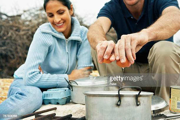 Couples Cooking at Camp