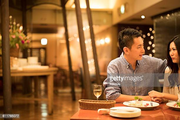 Couples dating in the modern restaurant