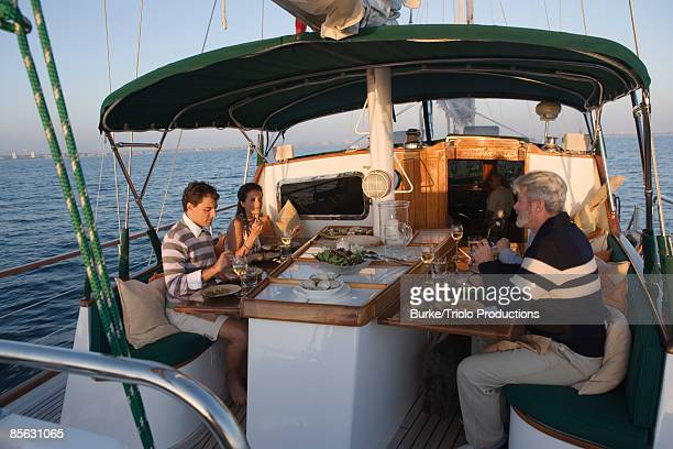Couples dining on sailboat