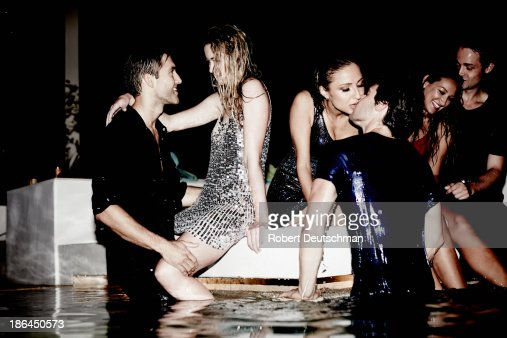 Couples dressed up, showing affection by the pool. : Stock Photo