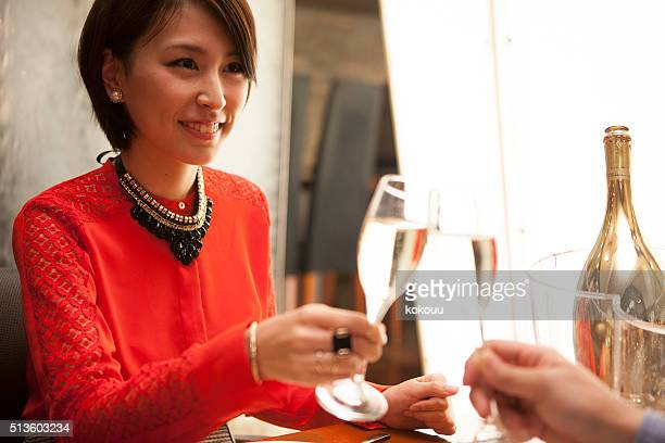 Couples drinking champagne in the restaurant