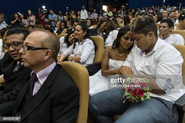 Couples during their wedding ceremony at the Court of Justice of the State of Rio de Janeiro on December 8 2013 130 gay couples are getting married...