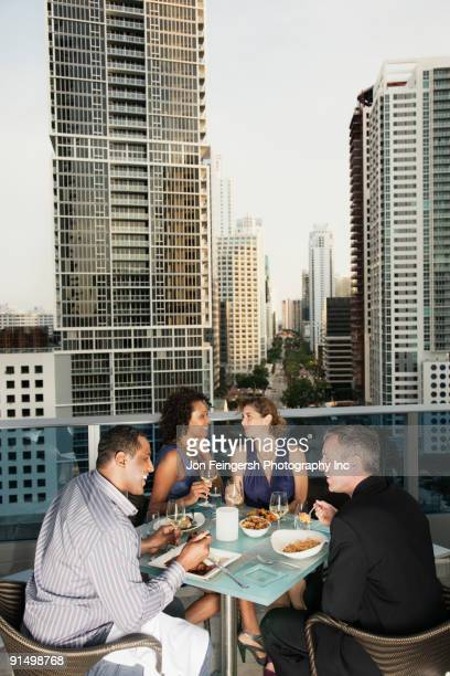Person on balcony overlooking city stock photos and for Balcony overlooking city