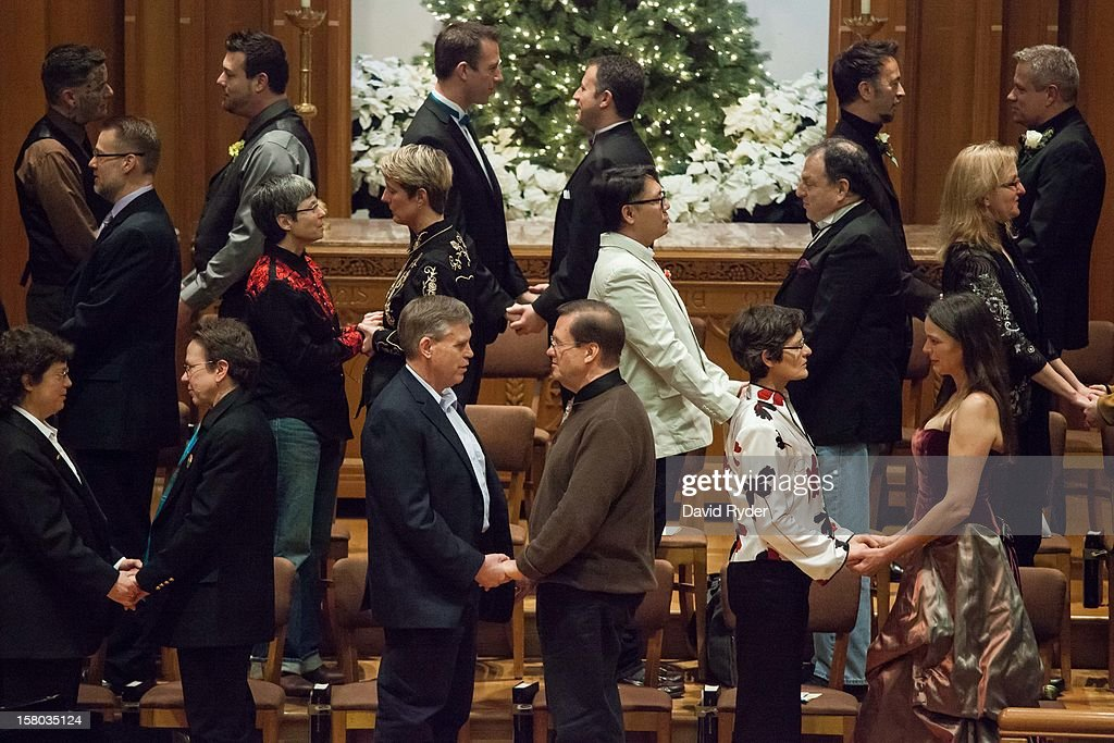 Couples exchange vows during a mass wedding for 25 same-sex partners at Seattle First Baptist Church on December 9, 2012 in Seattle, Washington. Today is the first day that same-sex couples can legally wed in Washington state.