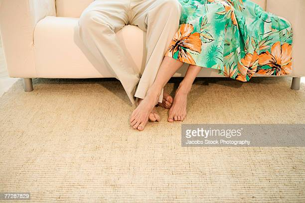 Couple's feet in living room