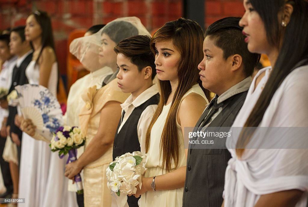 Couples from the lesbian, gay, bisexual and transgender (LGBT) community take part in a 'Rite of Holy Union' ceremony in Manila on June 26, 2016, that coincided with Gay Pride celebrations the day before. The Philippines has a vibrant gay scene despite a macho culture and opposition from the Roman Catholic Church, but there are no anti-discrimination laws in the country and same-sex relationships are not officially recognised. / AFP / NOEL