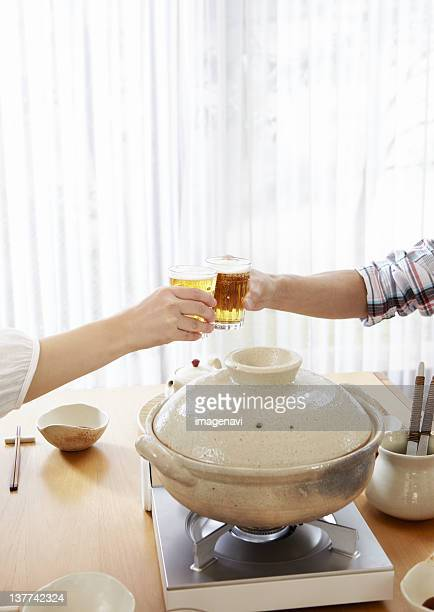 Couple's hands having a toast with beer