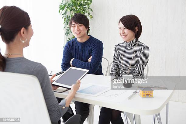 Couples have a discussion with a real estate agent