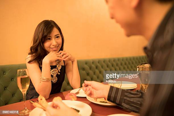 Couples have a meal in the fashionable restaurant