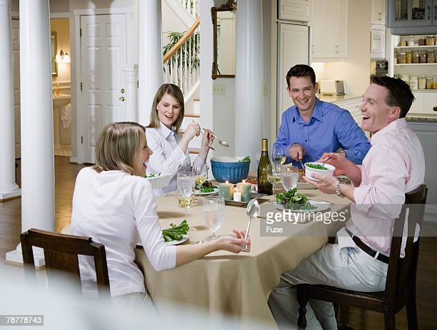 Couples Having Dinner Party