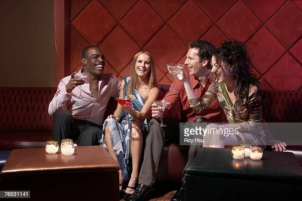 Couples having drinks in bar