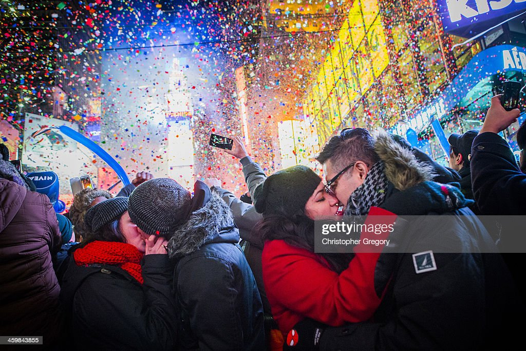 Couples kiss after midnight in Times Square during the New Years Eve celebration on January 1 2013 in New York City An estimated one million revelers...