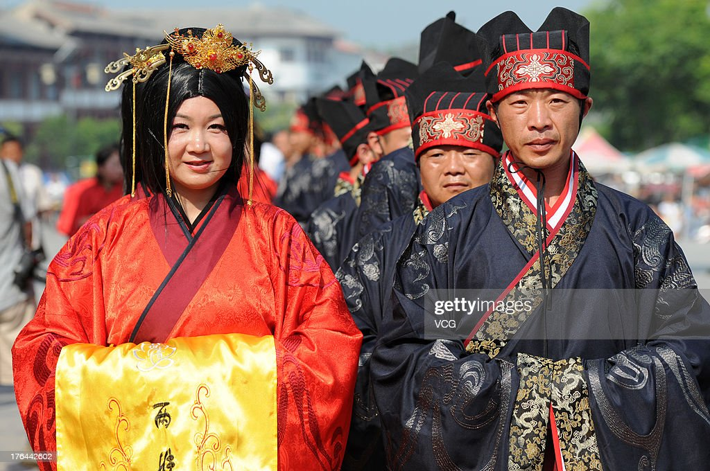 20 couples of newlyweds wearing Han Chinese clothes attend the group wedding ceremony to greet the Chinese Valentine's Day at Pujiu Temple on August 13, 2013 in Yongji, China. The Chinese Valentine's Day falls on the 7th day of the 7th month on the Chinese lunar calendar which falls on August 13 this year.