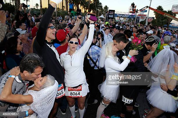 Couples participate in the runthrough wedding ceremony during the Rock 'n' Roll Las Vegas Marathon and Half Marathon benefitting the Crohn's Colitis...