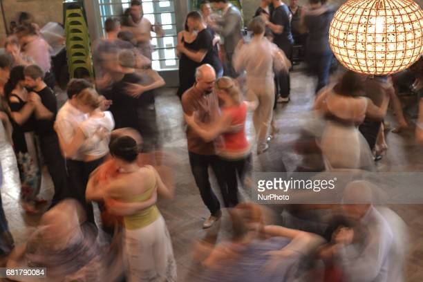 Couples perfom Argentine tango during an afternoon milonga event in Hevre Pub an event that was a part of Krakus Aires Tango Festival 2017 a...