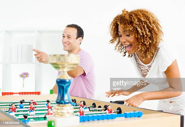 Couples Playing Foosball.