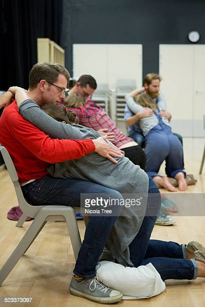 Couples practicing birthing positions