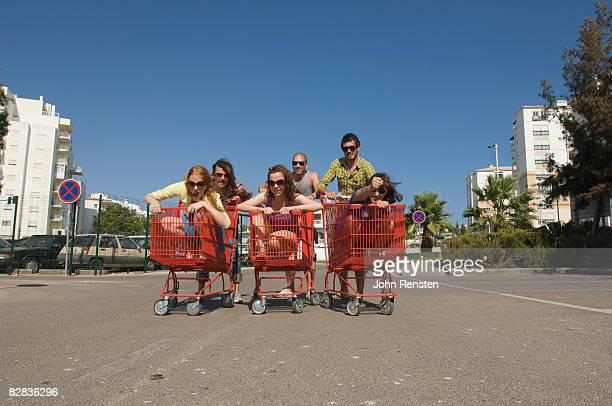 couples racing supermarket trolleys