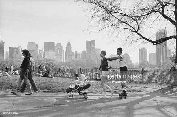 Couples relax in the sunshine in New York City circa 1982