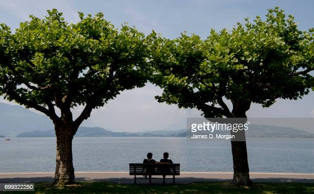 Couples seek shade beside the lake on the longest day of 2017 on June 21 2017 in Zug Switzerland The summer solstice was celebrated in the...