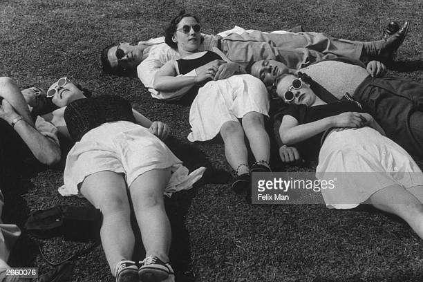 Couples sunbathing on the grass at Butlin's Holiday Camp Skegness Original Publication Picture Post 193 Holiday Camp pub 1939
