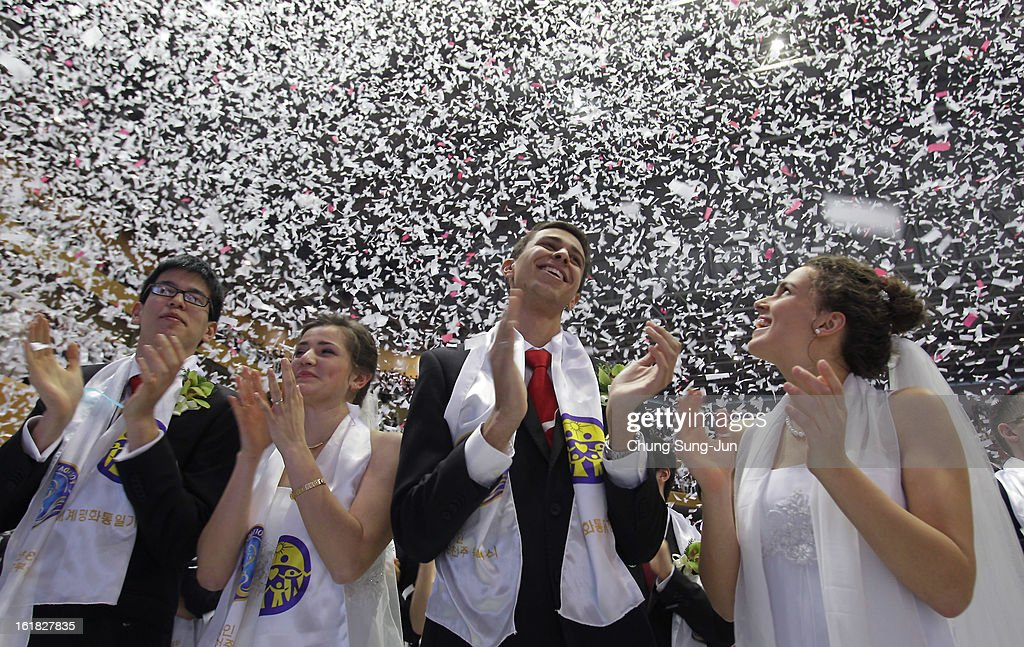Couples take part in a mass wedding ceremony at Cheongshim Peace World Center on February 17, 2013 in Gapyeong-gun, South Korea. 3,500 couples from 200 countries around the world exchanged wedding vows for the first time after the Unification Church founder Moon Sun-Myung passed away.