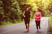 Couples take vacations jogging in the forest. The integrity and refreshing