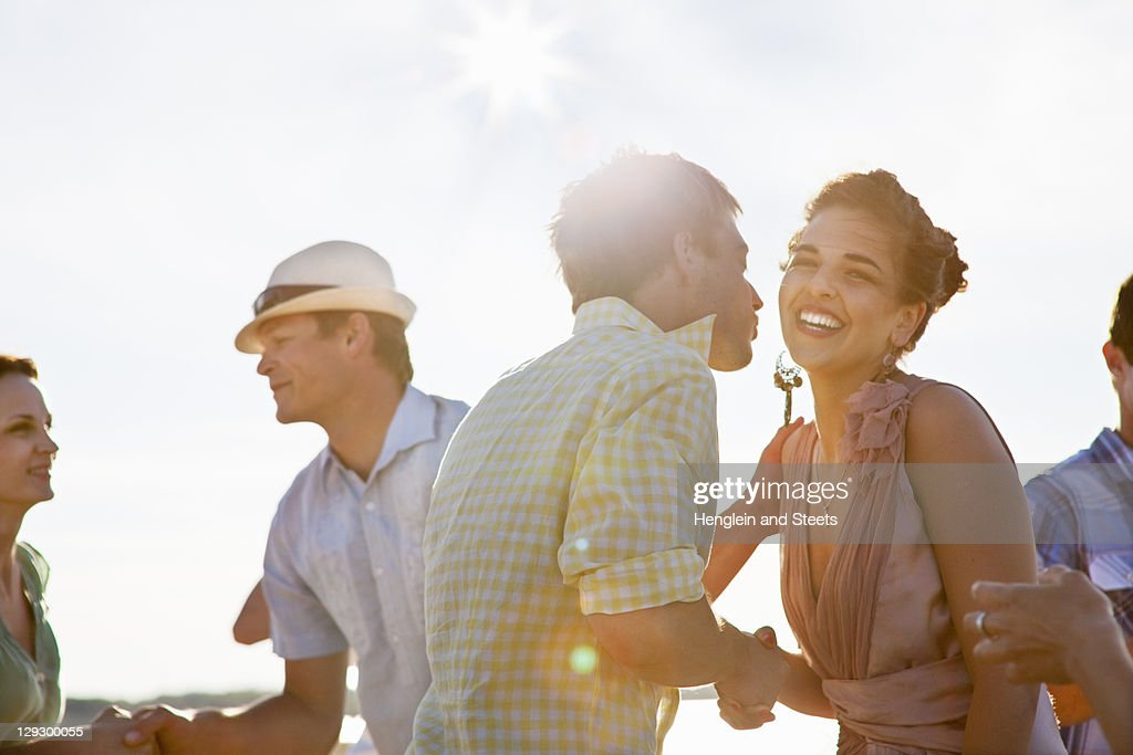 Couples talking on beach : Stock Photo