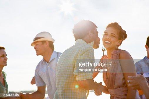 Couples talking on beach : Stock Photo