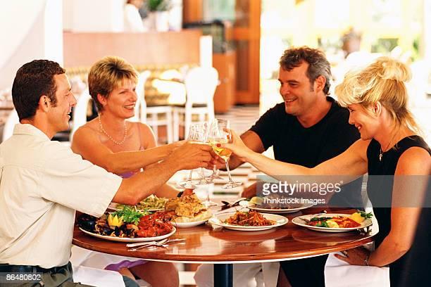 Couples toasting wine