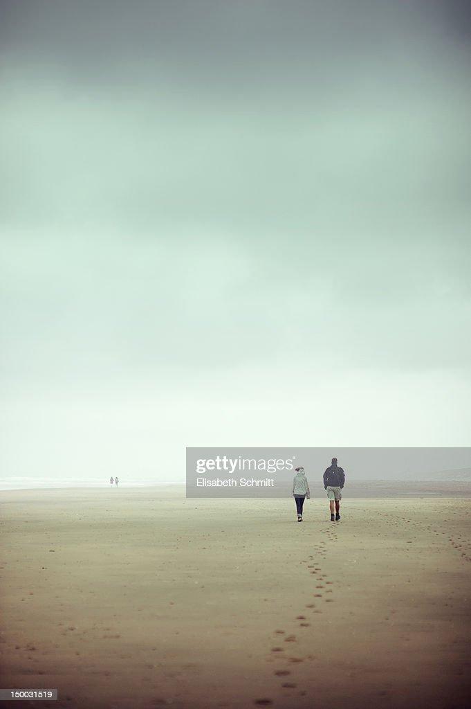 Couples walking along beach